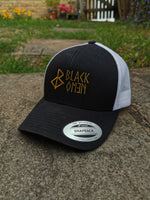 BLACK OMEN TRUCKER HAT / BLACK / WHITE / OLD GOLD