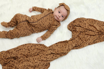 bamboo zip up footed sleeper, leopard print, and matching headband and blanket