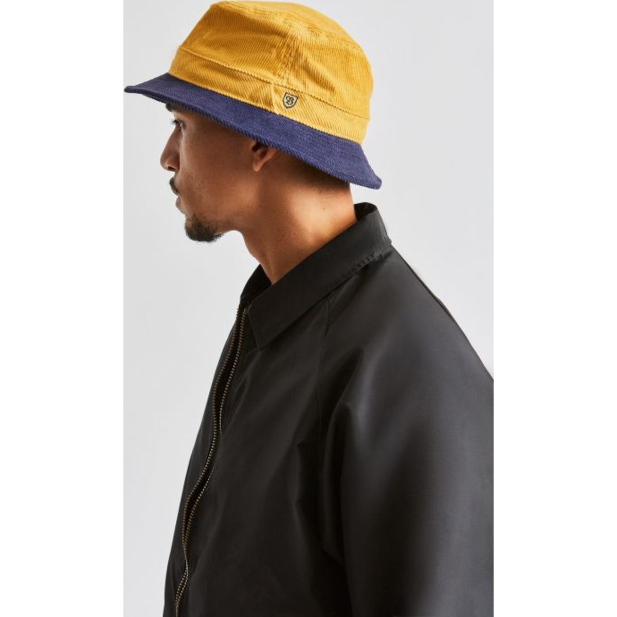 BRIXTON B-SHIELD BUCKET HAT - SUNSET YELLOW/WASHED NAVY