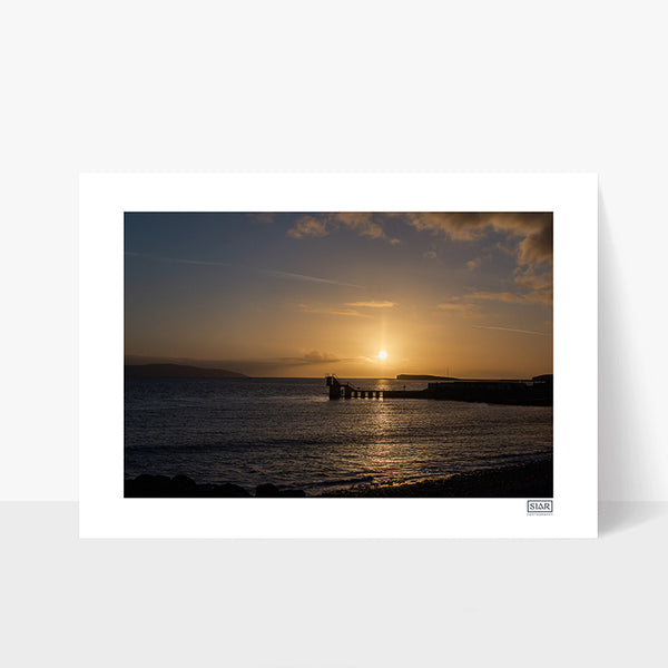 A sunset photograph of The Blackrock Diving Tower at Salthill Beach Galway