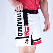 Load image into Gallery viewer, Side View of model wearing white, black, and red Jordan Trained Elite Wrestling Shorts. Established 1995