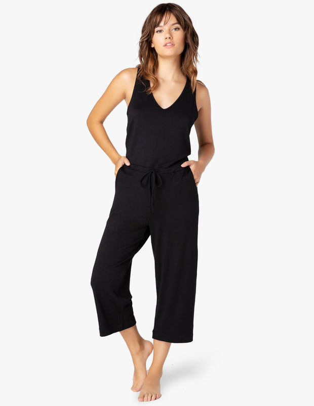 A one piece jumpsuit with a v neck sleeveless with a wide crop leg