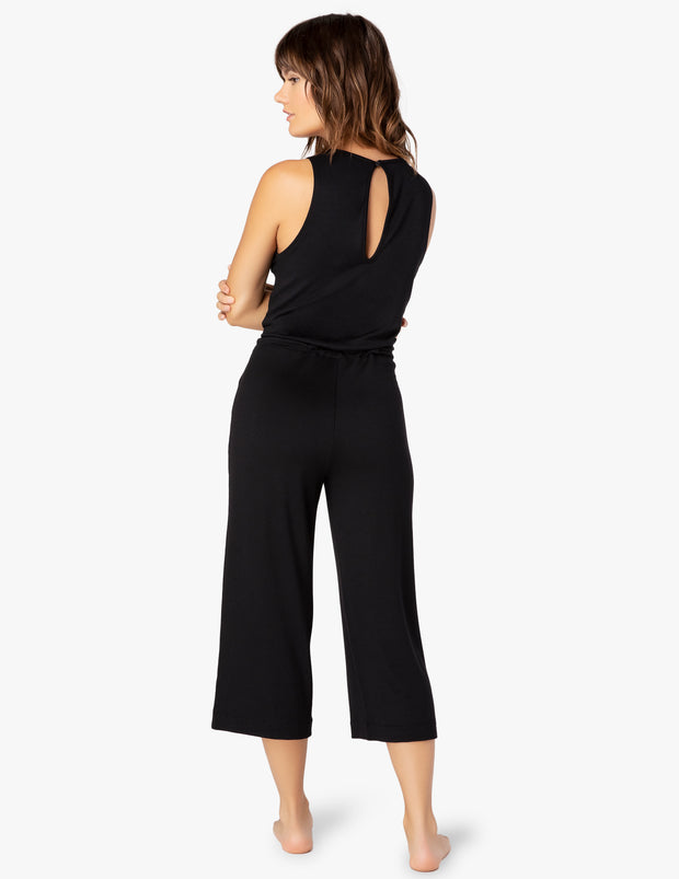 A one piece jumpsuit with a v neck sleeveless with a wide crop leg - back view with keyhole detail below neck