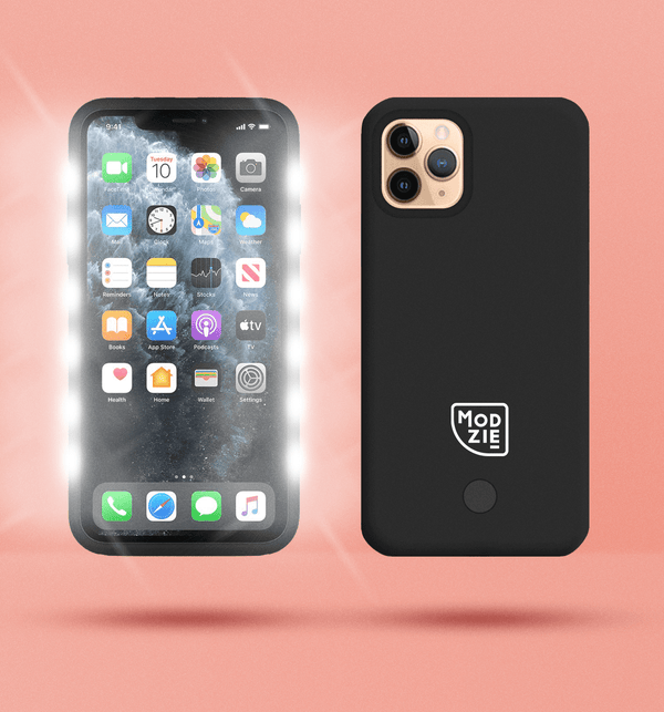 2 black floating iphone cases side by side and back to front. Case on the left has flashing lights either side of the case. Case on the right has a white Modzie logo bottom centre and a button below the logo. Both cases have a black shadow under the cases and pink background.