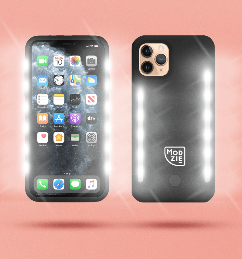 2 black floating iphone cases side by side and back to front. Case on the left has flashing lights either side of the case. Case on the right has a white Modzie logo bottom centre and a button below the logo with flashing lights either side of the case. Both cases have a black shadow under the cases and pink background.