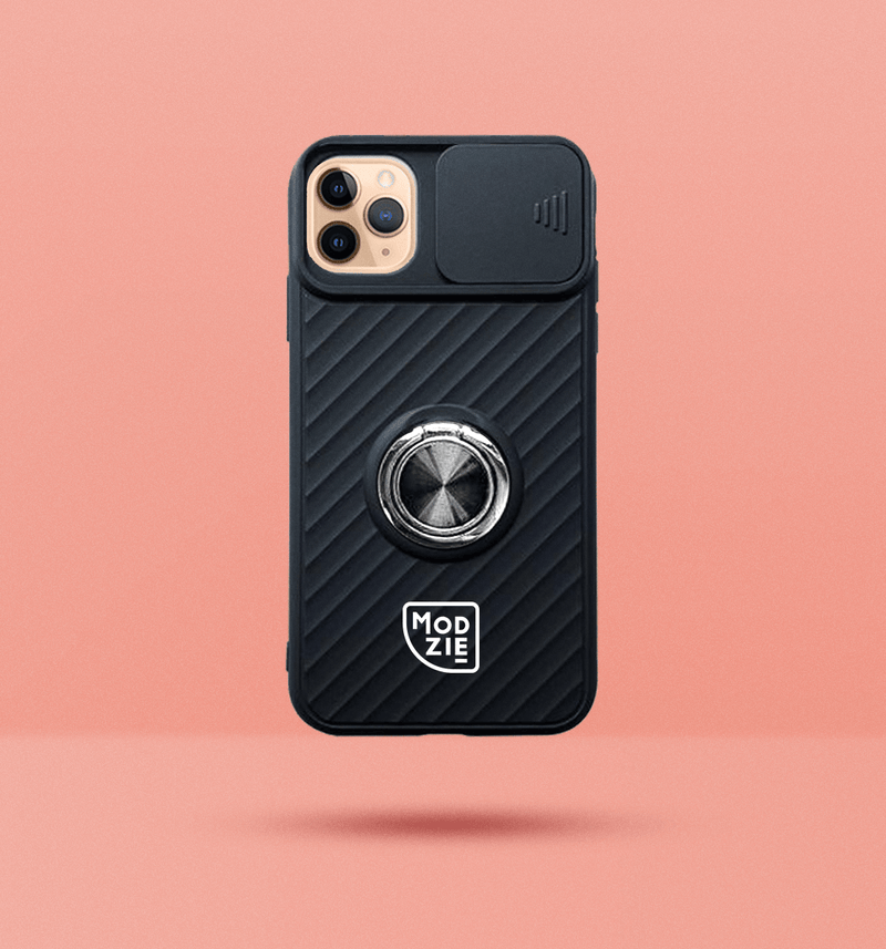black iPhone case with camera slider. Silver circle grip ring in the centre of the case and white Modzie logo under the grip ring. Black drop shadow under case and pink background.