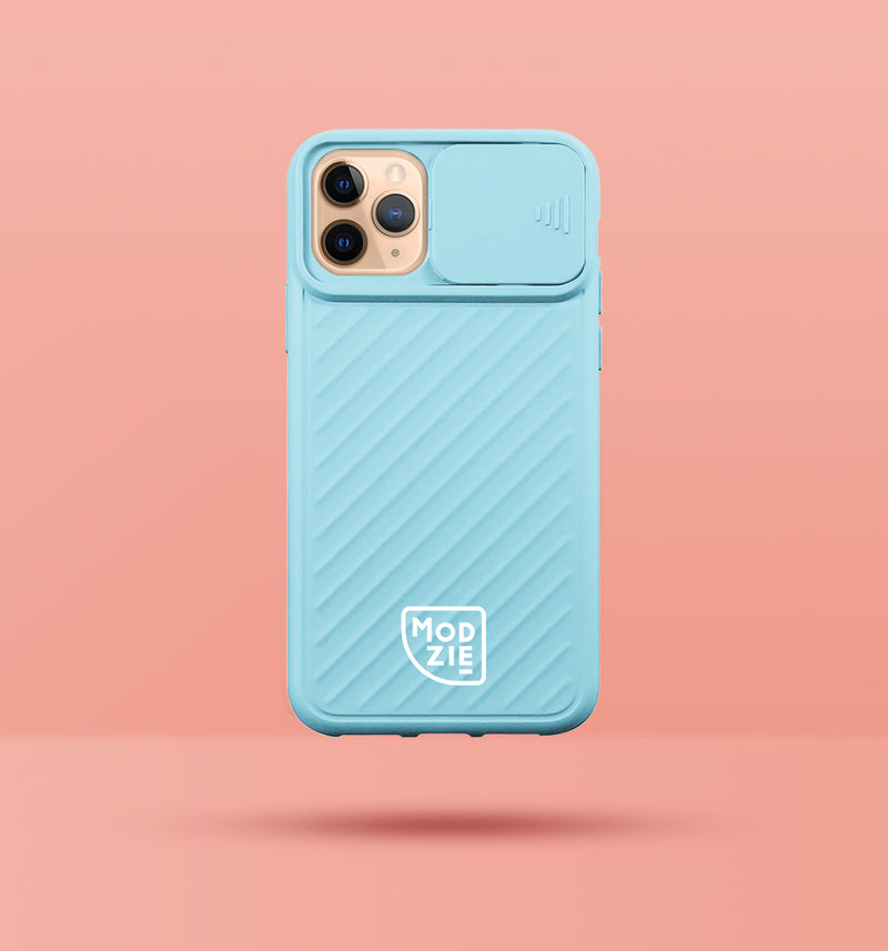 light blue iphone case with camera slider, with white Modzie logo bottom centre, with a pink background and black drop shadow under case