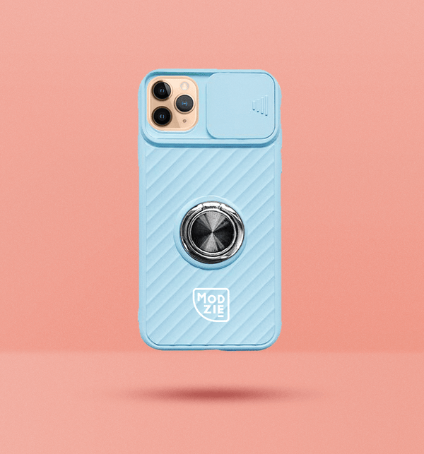light blue iPhone case with camera slider. Silver circle grip ring in the centre of the case and white Modzie logo under the grip ring. Black drop shadow under case and pink background.