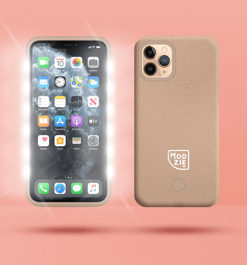 2 gold floating iphone cases side by side and back to front. Case on the left has flashing lights either side of the case. Case on the right has a white Modzie logo bottom centre and a button below the logo. Both cases have a black shadow under the cases and pink background.