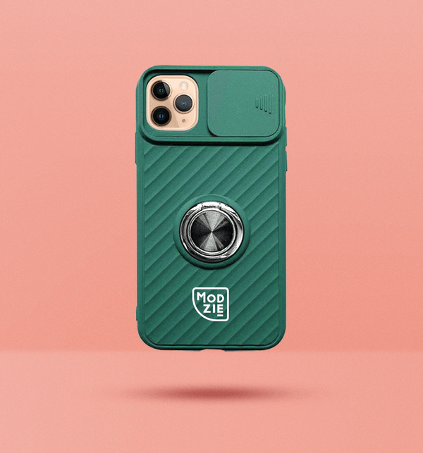 dark green iPhone case with camera slider. Silver circle grip ring in the centre of the case and white Modzie logo under the grip ring. Black drop shadow under case and pink background.