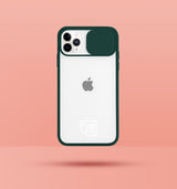 green clear iphone case with camera slider, with white Modzie logo bottom centre, with a pink background and black drop shadow under case
