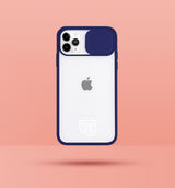 dark blue clear iphone case with camera slider, with white Modzie logo bottom centre, with a pink background and black drop shadow under case