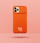 orange iphone case with camera slider, with white Modzie logo bottom centre, with a pink background and black drop shadow under case