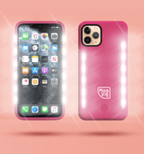 2 red floating iphone cases side by side and back to front. Case on the left has flashing lights either side of the case. Case on the right has a white Modzie logo bottom centre and a button below the logo with flashing lights either side of the case. Both cases have a black shadow under the cases and pink background.