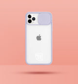 purple clear iphone case with camera slider, with white Modzie logo bottom centre, with a pink background and black drop shadow under case