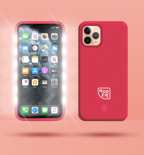2 red floating iphone cases side by side and back to front. Case on the left has flashing lights either side of the case. Case on the right has a white Modzie logo bottom centre and a button below the logo. Both cases have a black shadow under the cases and pink background.