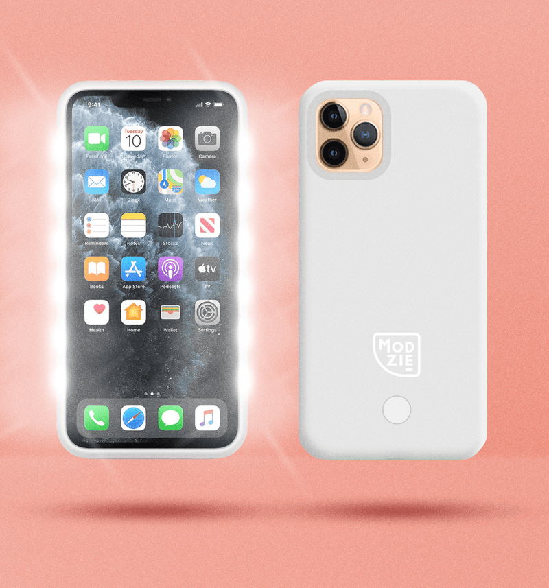 2 white floating iphone cases side by side and back to front. Case on the left has flashing lights either side of the case. Case on the right has a white Modzie logo bottom centre and a button below the logo. Both cases have a black shadow under the cases and pink background.