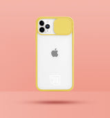 yellow clear iphone case with camera slider, with white Modzie logo bottom centre, with a pink background and black drop shadow under case
