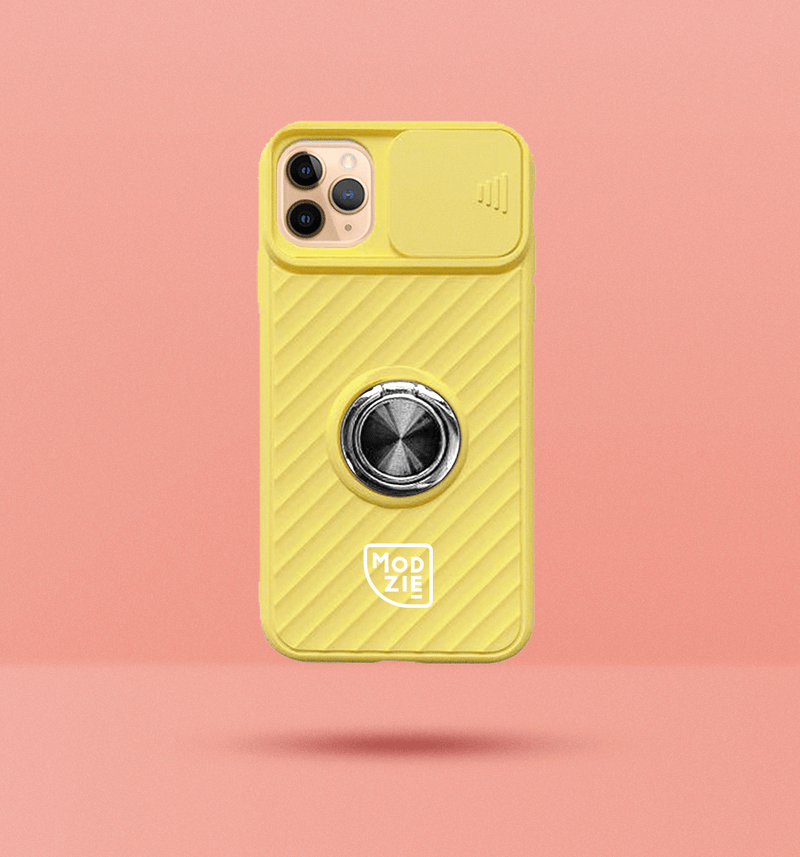 bright yellow iPhone case with camera slider. Silver circle grip ring in the centre of the case and white Modzie logo under the grip ring. Black drop shadow under case and pink background.
