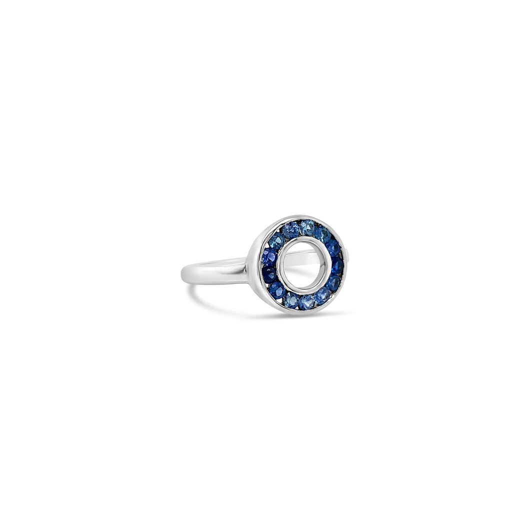 A Circle of Sapphires in a White Gold Setting