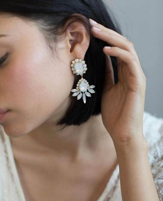 A gorgeous set of crystal adorned earrings that are sure to add glamour to any bridal or formal look