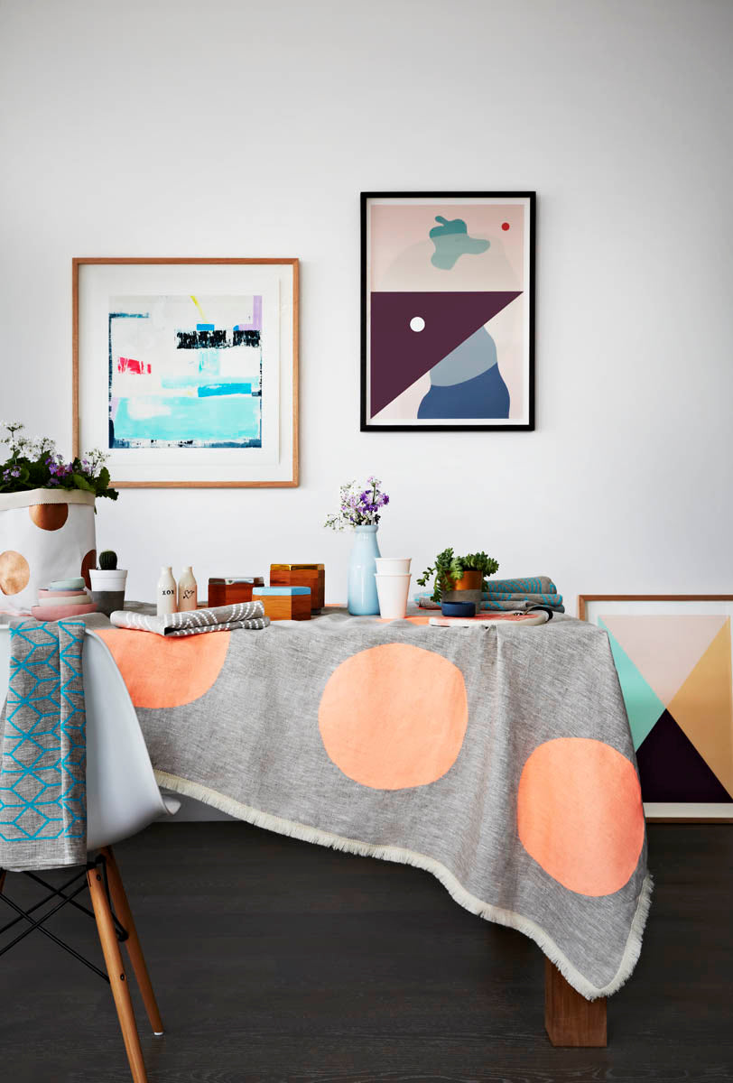 Styled dining table linen accessories and art