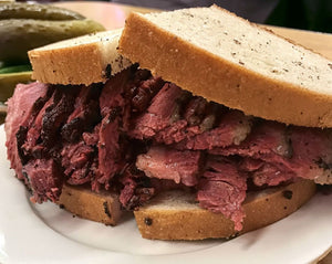 A Katz deli style sandwich made with Pastrami