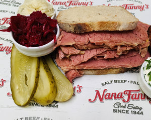 This is our Salt Beef reheated, sliced and served in a classic rye bread. We've added pickled gherkins and latkes
