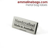 "Metal Bag Labels ""Handcrafted - Made in Australia"" in Nickel & Brass by Emmaline Bags"