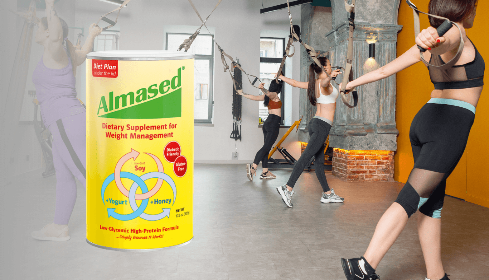 3 girls in the gym doing stretching exercises and a can of alamsed original flavor in the foreground