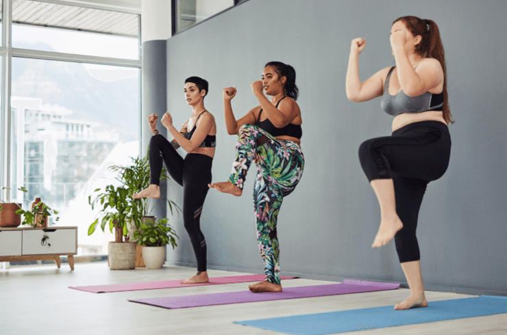 Group_of_young_women_exercising_together