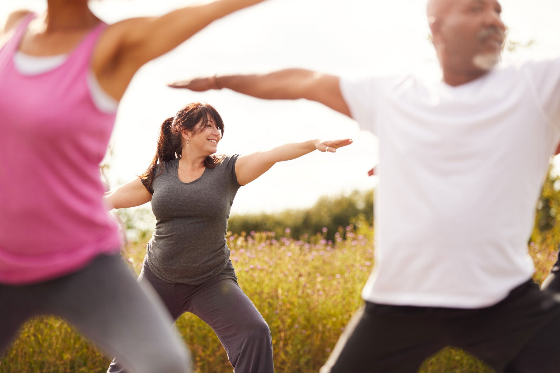 group of people exercising in nature