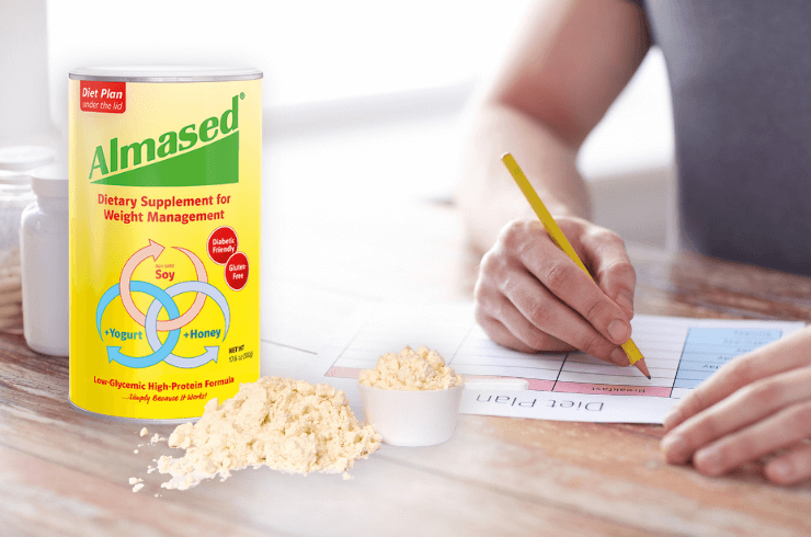 hands_writting_out_diet_plan_on_kitchen_counter_with_can_of_Almased_in_the_foreground