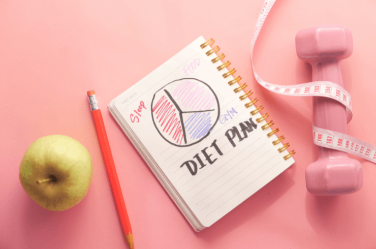 on_pink_background_apple_pencil_diet_notebook_pink_barbell_and_measuriing_tape