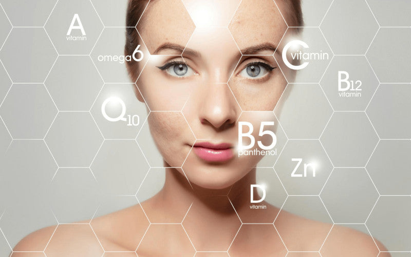 blue-eyed woman with a geometric background of vitamins a b c