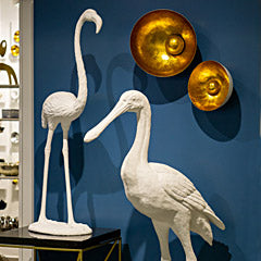 White bird sculptures and Natsu Wall Art at Gold Leaf Design Group tradeshow space.