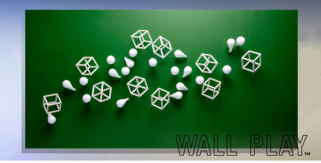 Cubical and fig wall play on green substrate.