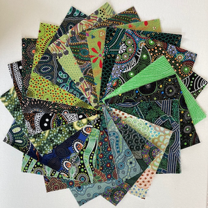 "The Dreamtime 5"" Square packs in green are comprised of 20 different prints of Australian Aboriginal fabric by M&S Textiles Australia, 2 squares of each print for a total of 40 squares."