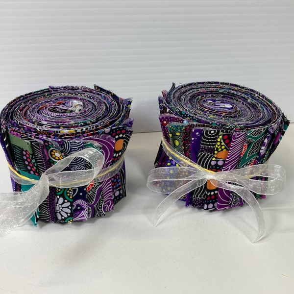 "The Dreamtime Rolls of 20 purple Australian Aboriginal Fabric strips (2.5"" wide, 42"" long) are composed of 20 different prints, one strip of each."