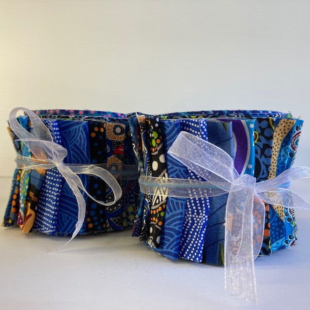 "The Dreamtime Rolls of 20 blue Australian Aboriginal Fabric strips (2.5"" wide, 42"" long) are composed of 20 different prints, one strip of each."
