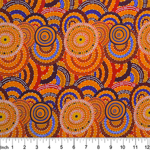 Womens Body Dreaming mustard Australian Aboriginal fabric by Cindy Wallace is a celebration of all things women: Orange, red and blue circles on a yellow background are a delight for the eye.