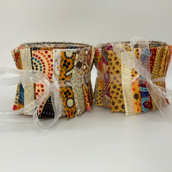 "The Dreamtime Rolls of 20 yellow Australian Aboriginal Fabric strips (2.5"" wide, 42"" long) are composed of 20 different prints, one strip of each."