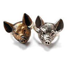 Load image into Gallery viewer, one bronze and one sterling silver pig ring on white background
