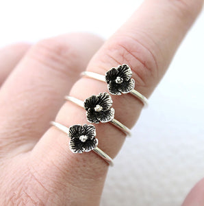 3 flower rings on finger