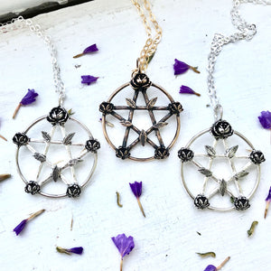 pentacle pendant with twigs and flowers
