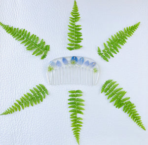 blue delphinium hair comb with green ferns surrounding