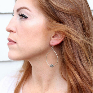 side profile of a beautiful auburn colored hair lady with rose earring