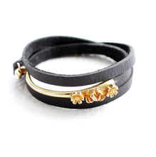 Load image into Gallery viewer, black leather wrap bracelet with 3 flowers
