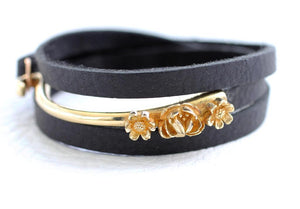 gold brass leather bracelet with a rose and two daises