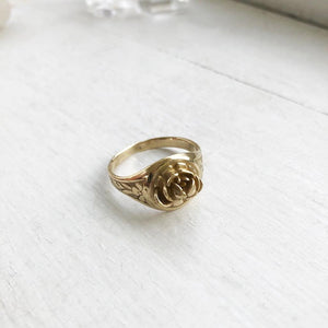 yellow brass rose signet ring with floral scrolls on side ring